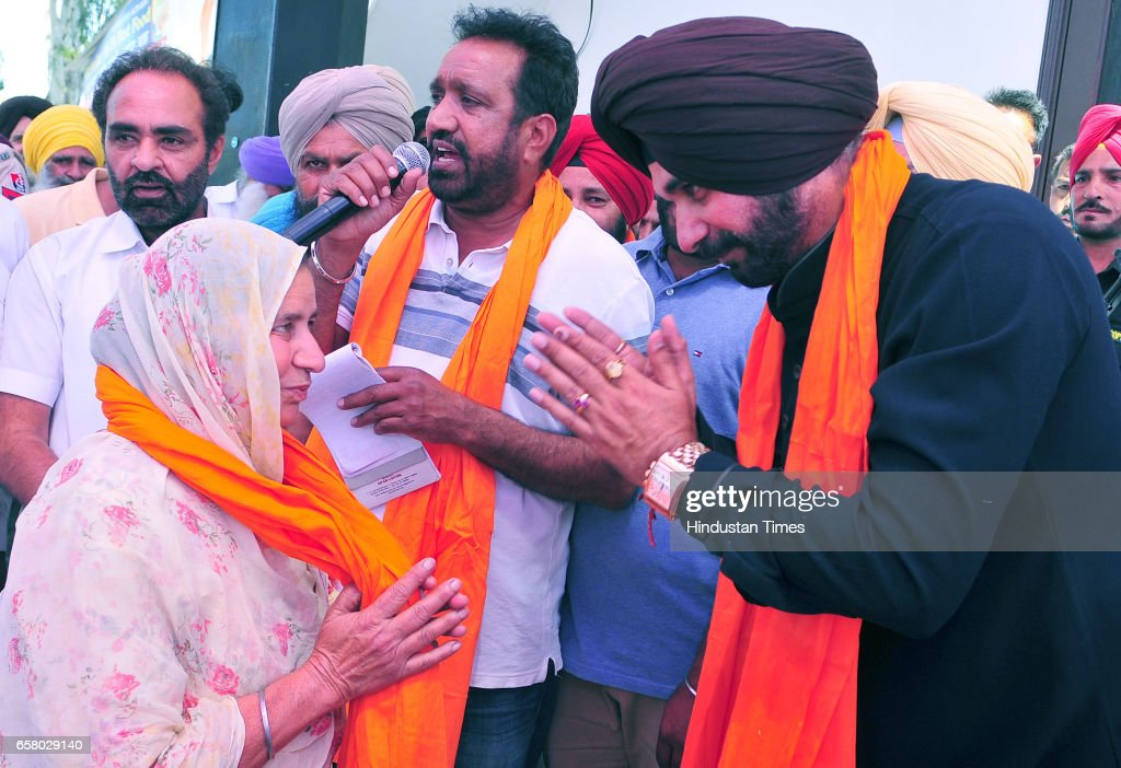 Punjab Local Bodies Minister Navjot Singh Sidhu during the thanksgiving visit to his constituency at Village Mudhal on March 26 2017 in Amritsar India