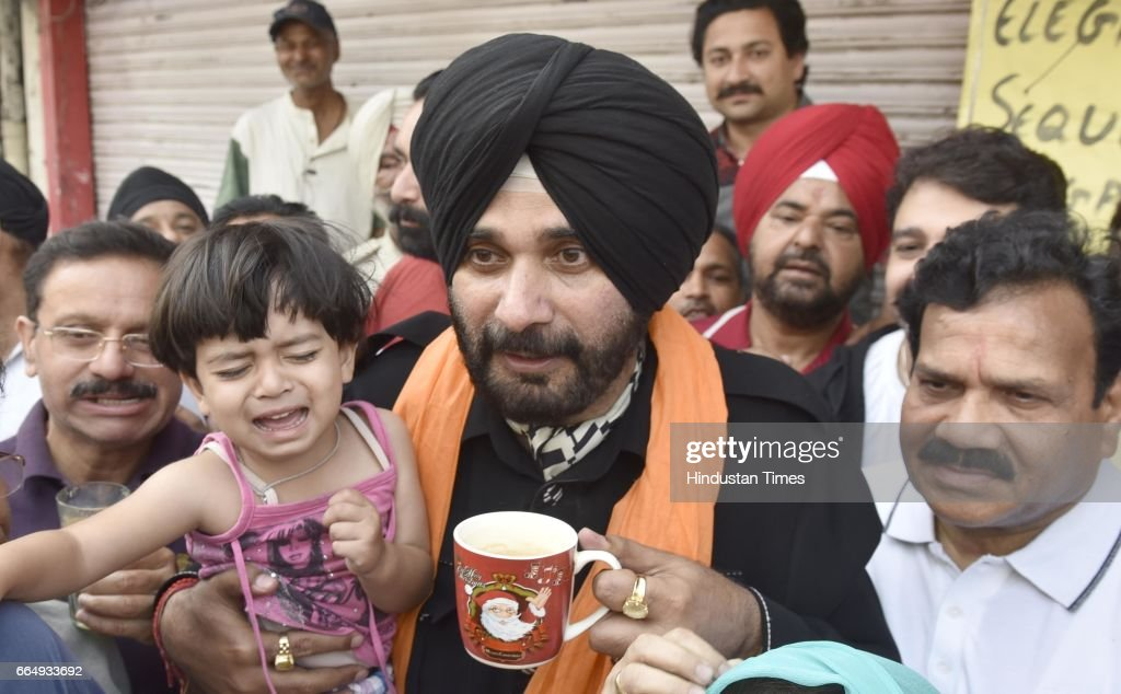 Punjab Local Bodies Minister Navjot Singh Sidhu enjoying the tea and sweets with city residents at Giani tea stall on April 5 2017 in Amritsar India