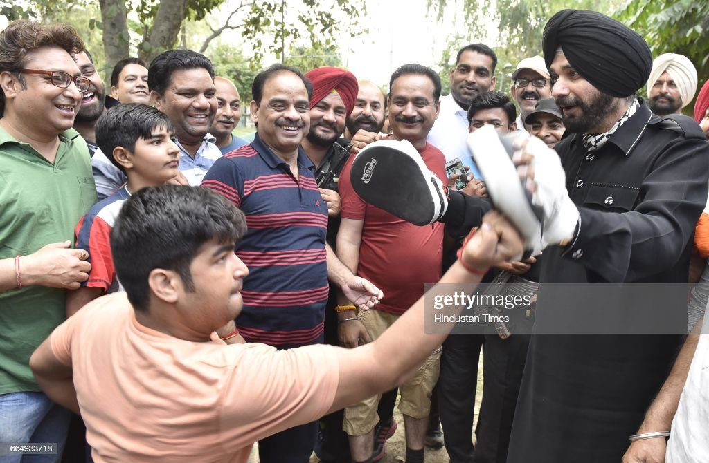 Punjab Local Bodies Minister Navjot Singh Sidhu playing boxing with city youngsters during his visit at famous Ram Bagh on April 5 2017 in Amritsar...