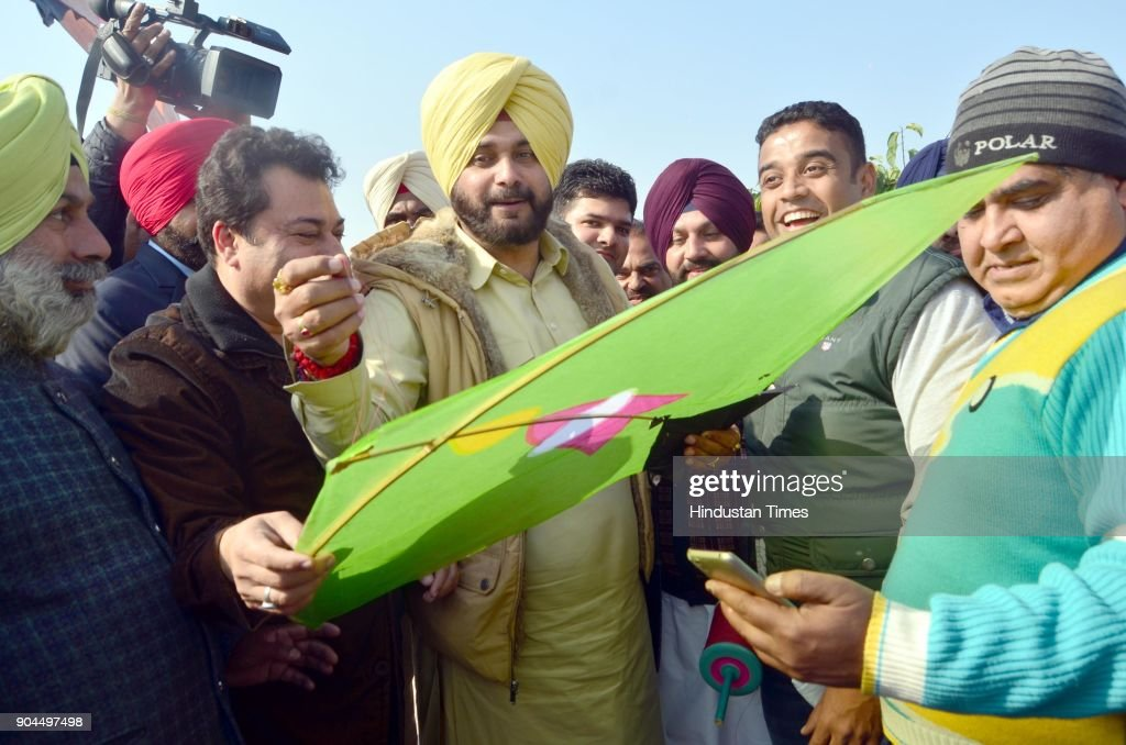 Punjab Local Bodies Minister Navjot Singh Sidhu with his supporters fly kites on the occasion of Lohri festival on January 13 2018 in Amritsar India..