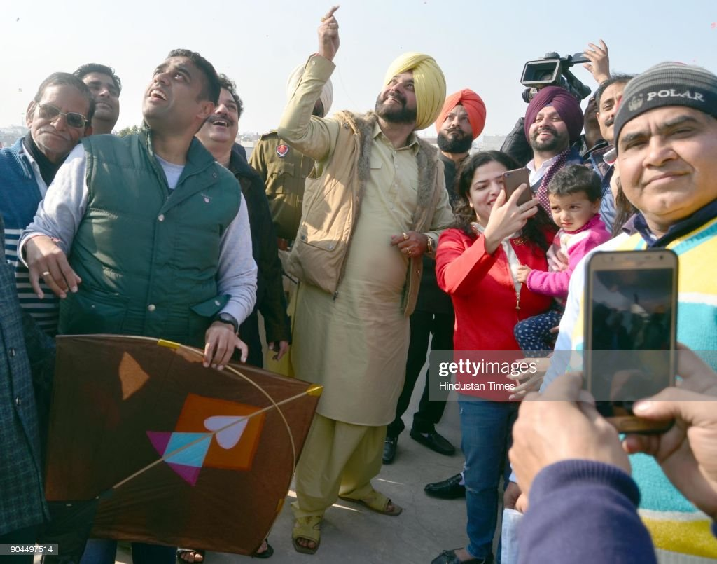 Punjab Local Bodies Minister Navjot Singh Sidhu with his supporters fly kites on the occasion of Lohri festival, on January 13, 2018 in Amritsar, India. Lohri is a great occasion that holds great importance for farmers. The festival of harvest, Lohri is being celebrated in North India especially in Punjab, Haryana, Himachal Pradesh and Delhi. Popcorns, peanuts, Rewari and Gajak are distributed to all neighbours, friends and relatives on the occasion.