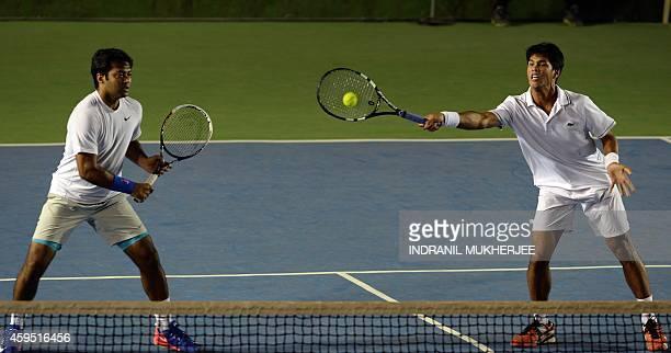 Punjab Marshals player Leander Paes looks on as teammate Somdev Devvarman plays a shot against Tommy Robredo and Sriram Balaji of Mumbai Tennis...
