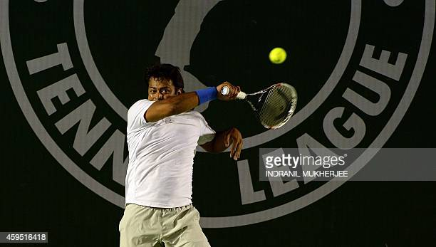 Punjab Marshals player Leander Paes plays a shot against Sergi Bruguera of Mumbai Tennis Masters during their Champions Tennis League match at the...