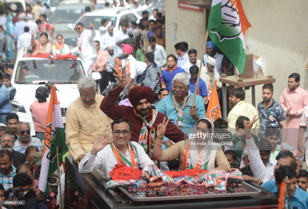 Punjab Minister Navjot Singh Sidhu and Delhi Congress Chief Ajay Maken during a roadshow in New Delhi