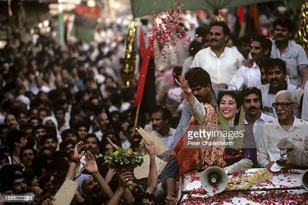 Benazir Bhutto works the crowd at a rally from the roof of a car She is the leader of the Pakistan People's Party proclaiming she would bring...