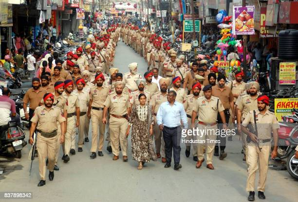 Punjab Police along with jawans of CRPF take out flag march to keep the law and order situation under control in the district as members of Dera...