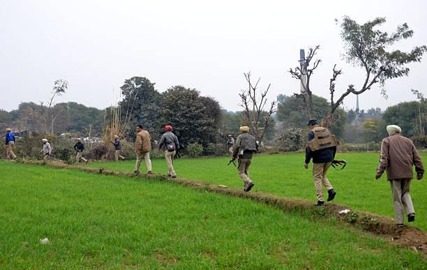 Punjab Police Jawans conducting a search operation at village Manwal during a terror strike at Pathankot Air Force Base on January 4 2015 in...