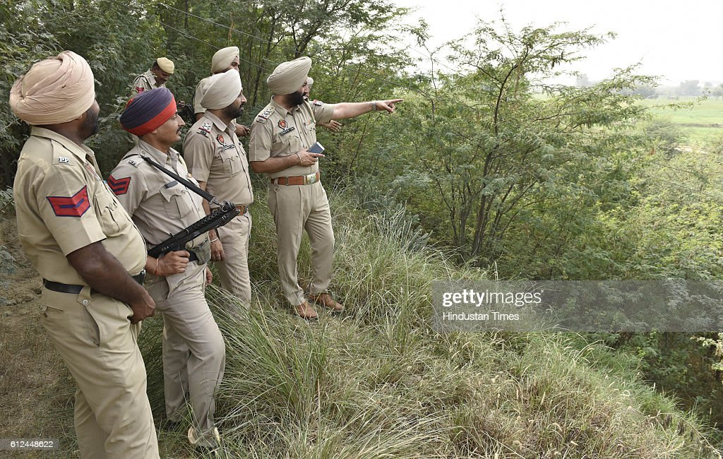 Punjab Police officials inspecting the village area near BOP Rear Kakkar post in Amritsar sector after Pakistani boat captured from Ravi River on...