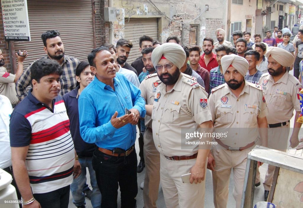 Punjab Police personnel detain protesters from the Shiv Sena Punjab organisation for allegedly trying to forcibly close shops during protests against.