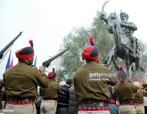 Punjab police personnel pay tribute to Sham Singh Atariwala on his martyrdom day on February 10 2014 in Amritsar India Sham Singh Attariwala was a...