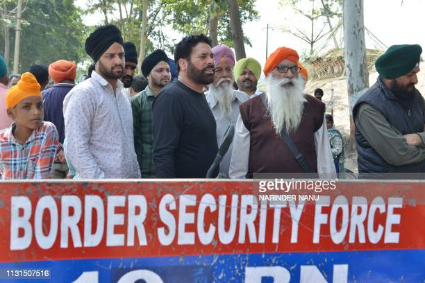 Punjab Police personnel prevent Sikh pilgrims from going ahead along a road at Dera Baba Nanak some 45 kms from Amritsar on March 19 2019 Indian and...