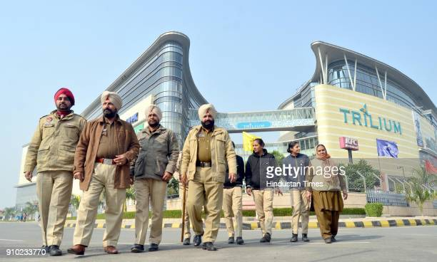 Punjab police personnel stands guard outside a Trillium mall scheduled to screen the Bollywood film 'Padmaavat' on January 25 2018 in Amritsar India...