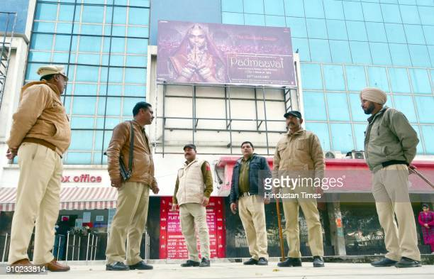 Punjab police personnel stands guard outside Suraj Chanda Tara cinema hall scheduled to screen the Bollywood film 'Padmaavat' on January 25 2018 in...