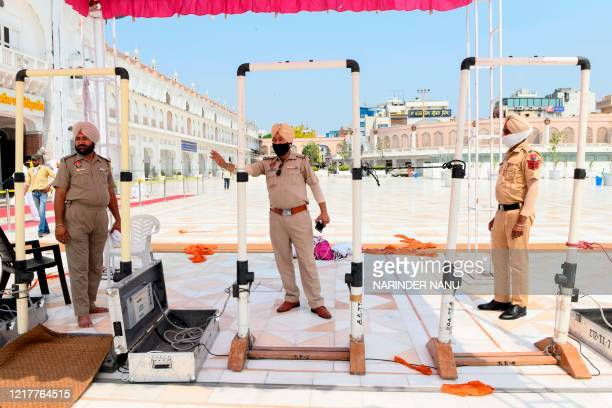 Punjab Police personnel wait for devotees to arrive at the Golden Temple on the eve of the 36th Operation Blue Star Anniversary, in Amritsar on June...