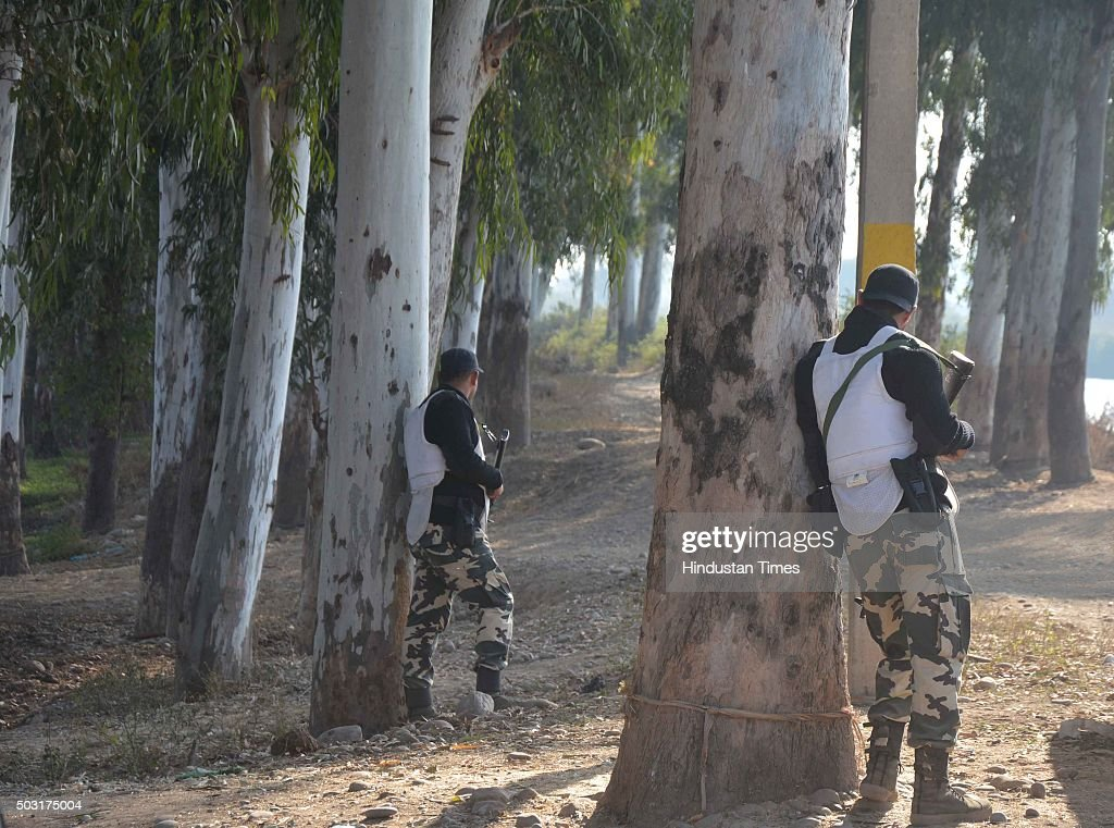 Punjab Police Swat Team security personnel guarding the road leading to Pathankot Air Force Station at Dhaki Chowk during an ongoing attack on the...