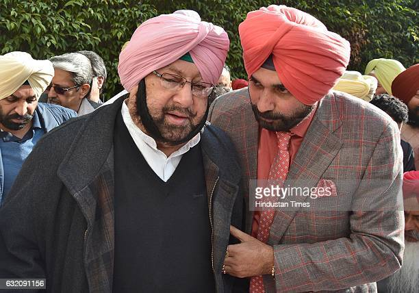 Punjab Pradesh Congress committee President Capt. Amarinder Singh along with Navjot Singh Sidhu, Congress candidate from East constituency, Amritsar,...