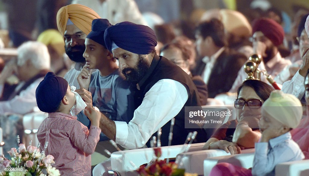 Punjab Revenue Minister Bikram Singh Majithia busy with his son on the Golden Jubilee celebrations of Punjabi Suba at Town hall on November 1 2016 in.