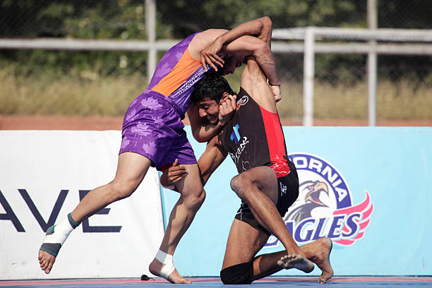 Punjab Thunder compete against Vancouver Lions during the 2014 World Kabaddi league tournament at Punjab Agricultural University Hockey Stadium on...