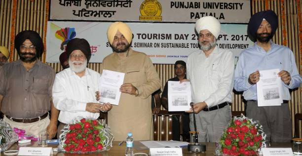 Punjab Tourism and Cultural Affairs Minister Navjot Singh Sidhu releases the Punjab Tourism Policy during the state level on Sustainable Tourism for..