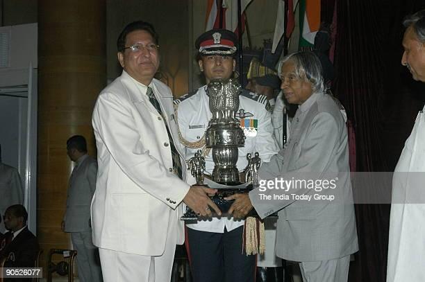 Punjab University Employee Receiving the Maulana Abul Kalam Azad Trophy from APJ Abdul Kalam, President of India at Sports and Adventure Awards-2005...