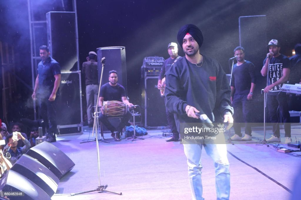 Punjabi actor and singer Diljit Dosanjh performs during the Confluence 2017 Hansraj College Annual Cultural Fest on March 6 2017 in New Delhi India