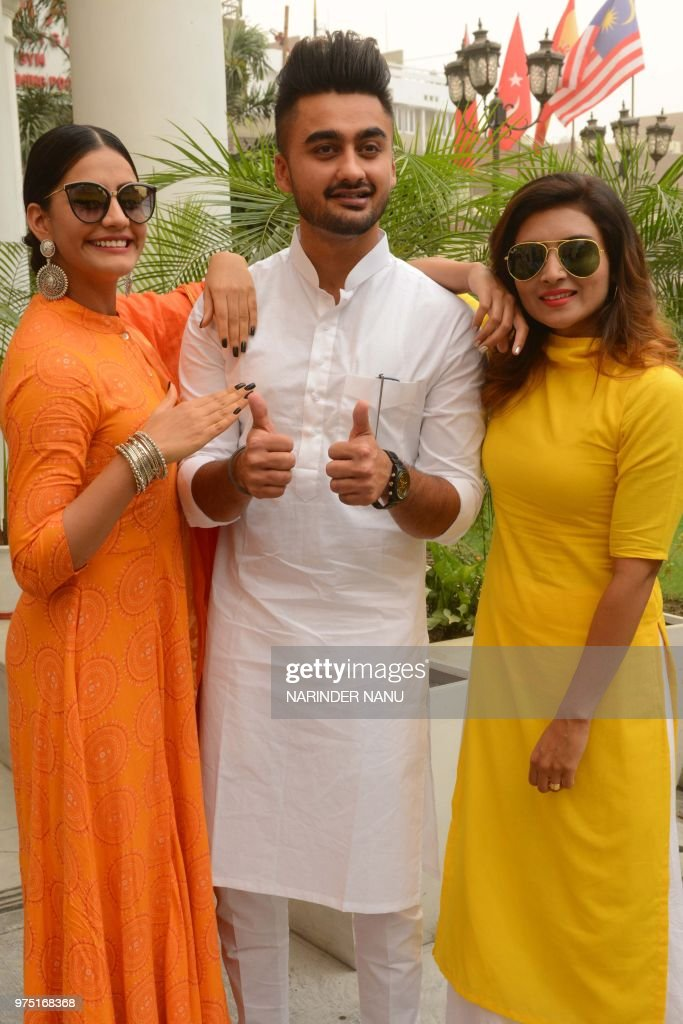 Punjabi actors Ravneet Singh Khushi Malhotra and Deep Sehgal pose for a photograph during a promotional event for the forthcoming Punjabi film `Jatt..