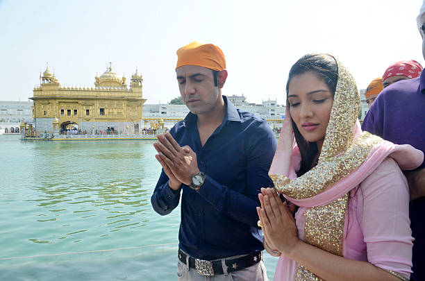 Punjabi actors Tina Ahuja and Gippy Grewal paying obeisance at Golden Temple at they visit the city for the promotions of their upcoming film Second..
