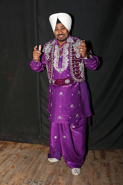 Punjabi Bhangra singer Lehmber Hussainpuri at the Baisakhi party organized by World Punjabi Organization on April 13 2013 in New Delhi India
