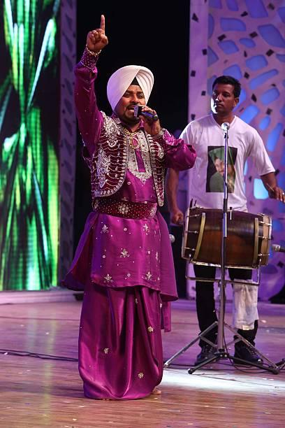 Punjabi Bhangra singer Lehmber Hussainpuri performs at the Baisakhi party organized by World Punjabi Organization on April 13 2013 in New Delhi India