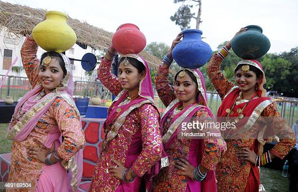 Punjabi folk dancers perform during the Baisakhi Mela 2015 on eve of Baisakhi Festival at Indira Gandhi National Centre for Arts Janpath on April 10...