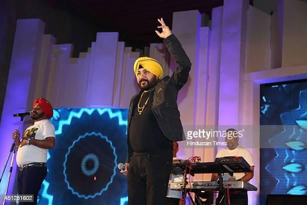 Punjabi pop singer Daler Mehandi performs at the wedding ceremony of Mayank Bajaj and Isha Kapoor on June 21 2014 in New Delhi India Mayank Bajaj is...