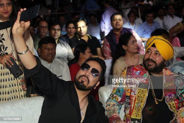 Punjabi Pop Singer Mika clicks selfie with his older brother and singer Daler Mehandi during Gata Rahe Mera Dil 2018 an annual cultural cum awards...