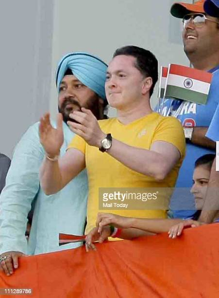 Punjabi singer Daler Mehndi and industralist Gautam Singhania cheer for team India during the first innings of the ICC cricket world cup semifinal...