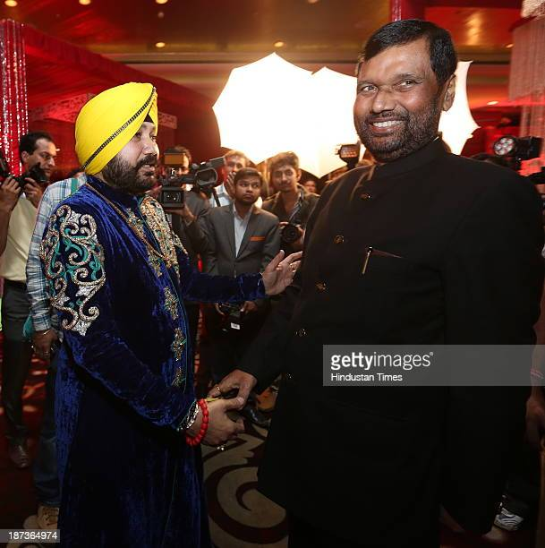 Punjabi singer Daler Mehndi greets LJP chief Ram Vilas Paswan during prewedding party of his daughter Ajit Kaur with Navraj Singh son of singer Hans...