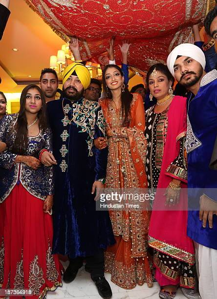 Punjabi singer Daler Mehndi poses with family during prewedding party of his daughter Ajit Kaur with Navraj Singh son of singer Hans Raj Hans on...