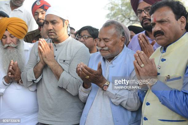 Punjabi singer Lakhwinder Wadali along with his father Sufi singer Puranchand Wadali and brother of Sufi singer Pyare Lal Wadali mourn as they pray...