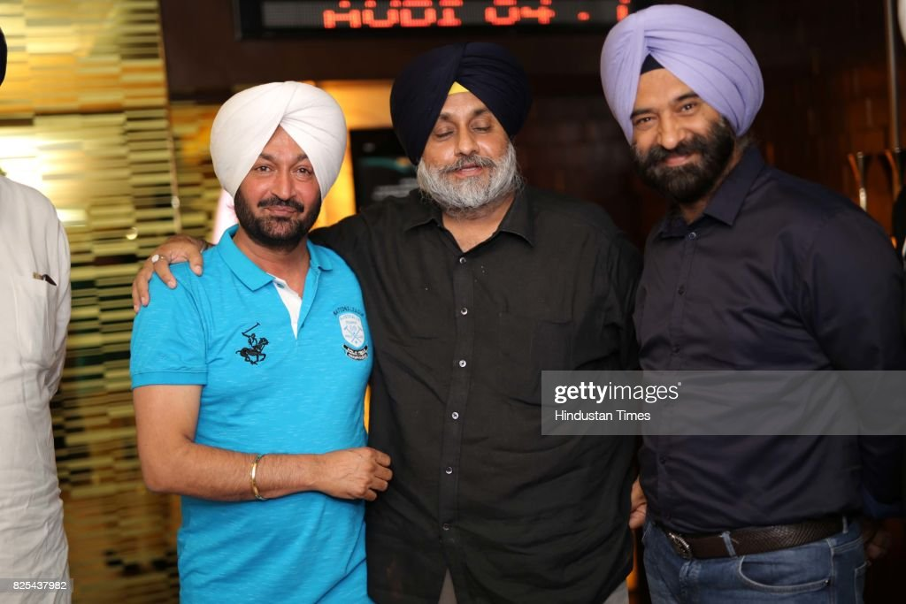 Punjabi singer Malkit Singh Senior SAD leader Sukhbir Singh Badal and BJP MLA Manjinder Singh Sirsa during the special screening of a movie `The...