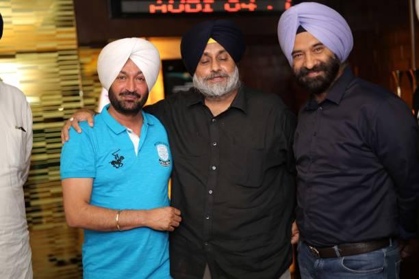 Punjabi singer Malkit Singh Senior SAD leader Sukhbir Singh Badal and BJP MLA Manjinder Singh Sirsa during the special screening of a movie `The...