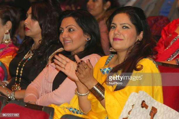 Punjabi women watch and clap as contestants compete in the Giddha folk dance segment during the Miss World Punjaban beauty pageant held in...