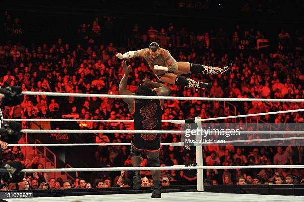 Punk and Mark Henry battle during their WWE match at the WWE Monday Night Raw Supershow Halloween event at the Philips Arena on October 31 2011 in...