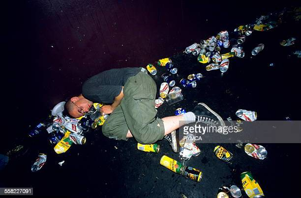 Punk asleep amoungst litter and beer cans on the floor at a gig London Astoria 1998