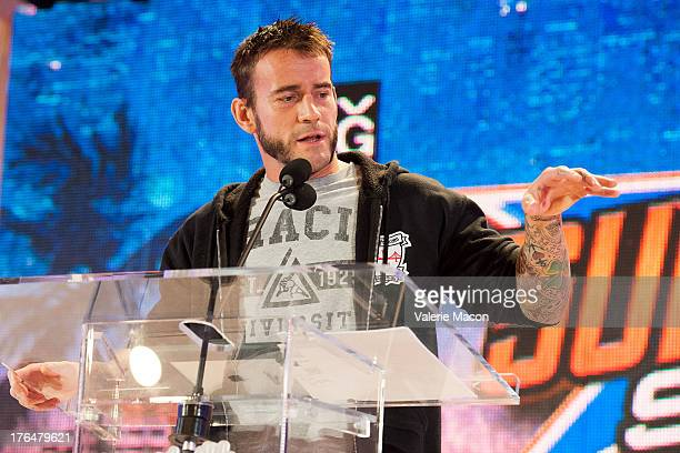 Punk attends WWE SummerSlam Press Conference at Beverly Hills Hotel on August 13 2013 in Beverly Hills California