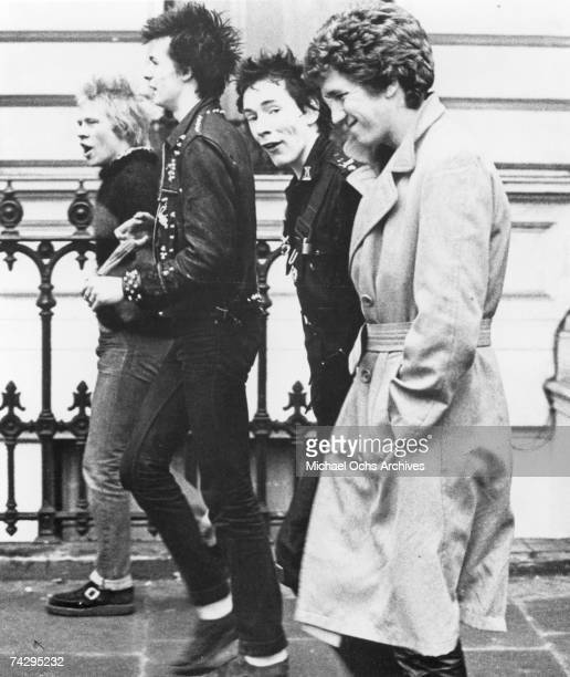 Punk band 'The Sex Pistols' walks down the street in 1977 Paul Cook Sid Vicious Johnny Rotten Steve Jones