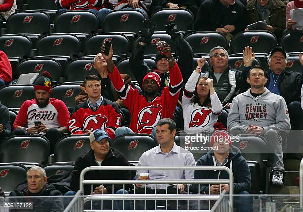 CM Punk Chris Wade Corey Anderson Jessica Eye and Forrest Griffin of the UFC take in the game between the New Jersey Devils and the Ottawa Senators...