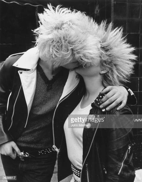 A punk couple kissing