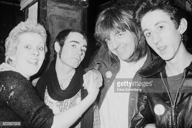 Punk fan Suzi with publicist BP Fallon musician and producer Nick Lowe and Andy Blade of Eater Hope and Anchor London November 1976