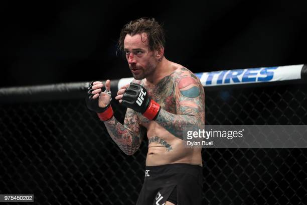 Punk fights in the first round in his welterweight bout against Mike Jackson during the UFC 225 Whittaker v Romero 2 event at the United Center on...