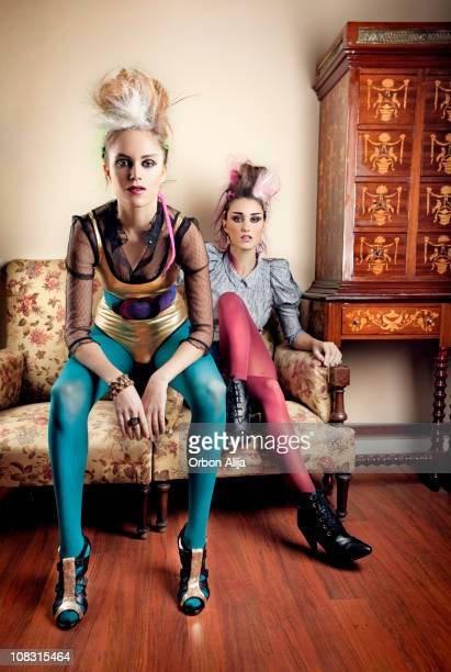 Punk girls in a retro living room