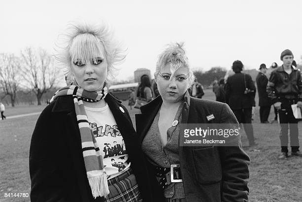 Punk girls in Hyde Park London 1979 Both young women have outrageous spiky hairstyles and have applied exaggerated eye makeup