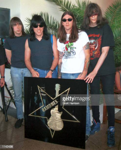 Punk icons the Ramones stand next to their gold star at the Las Vegas Hard Rock Cafe's Rock Walk of Fame in1996 in Las Vegas